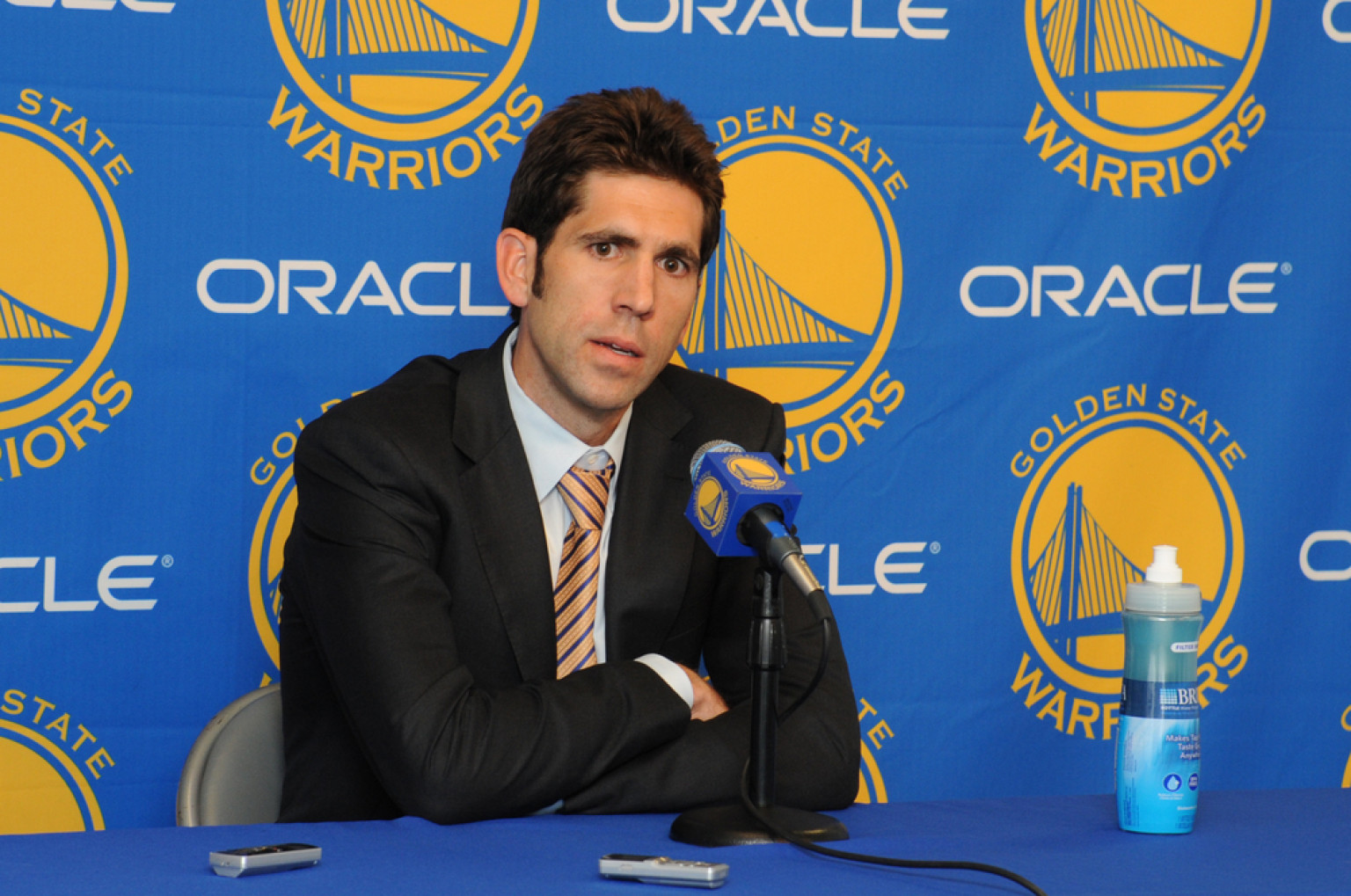 OAKLAND, CA - APRIL 26: Bob Myers, the new general manager of the Golden State Warriors, speaks to members of the media before a game against the San Antonio Spurs on April 26, 2012 at Oracle Arena in Oakland, California. NOTE TO USER: User expressly acknowledges and agrees that, by downloading and or using this photograph, user is consenting to the terms and conditions of Getty Images License Agreement. Mandatory Copyright Notice: Copyright 2012 NBAE (Photo by Garrett Ellwood/NBAE via Getty Images)
