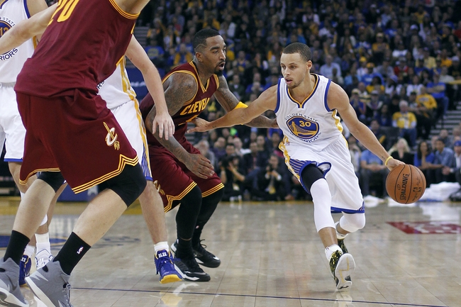 Jan 9, 2015; Oakland, CA, USA; Golden State Warriors guard Stephen Curry (30) dribbles past Cleveland Cavaliers guard J.R. Smith (5) in the third quarter at Oracle Arena. The Warriors defeated the Cavaliers 112-94. Mandatory Credit: Cary Edmondson-USA TODAY Sports