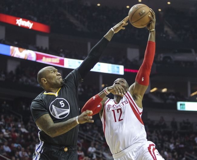 Jan 17, 2015; Houston, TX, USA; Houston Rockets center Dwight Howard (12) shoots as Golden State Warriors center Marreese Speights (5) defends during the first quarter at Toyota Center. Mandatory Credit: Troy Taormina-USA TODAY Sports