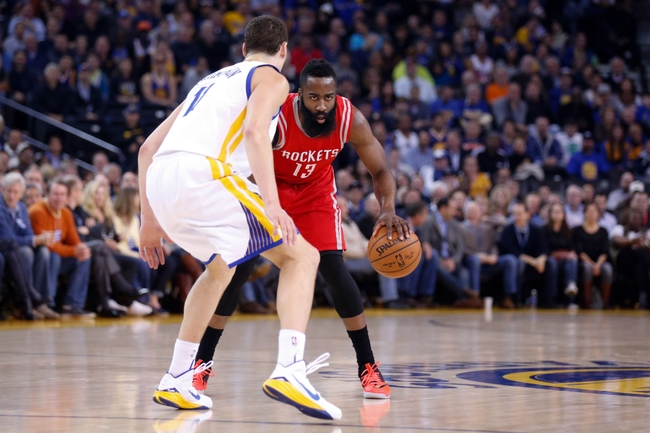Jan 21, 2015; Oakland, CA, USA; Houston Rockets guard James Harden (13) controls the ball against Golden State Warriors guard Klay Thompson (11) during the first quarter at Oracle Arena. Mandatory Credit: Kelley L Cox-USA TODAY Sports