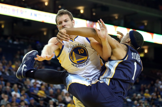 Apr 13, 2015; Oakland, CA, USA; Memphis Grizzlies forward Jarnell Stokes (1) fouls Golden State Warriors forward David Lee (10) during the fourth quarter at Oracle Arena. The Golden State Warriors defeated the Memphis Grizzlies 111-107. Mandatory Credit: Kelley L Cox-USA TODAY Sports