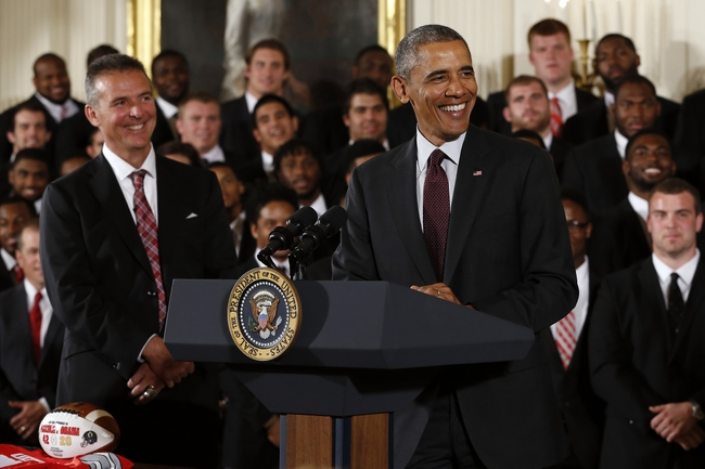 Apr 20, 2015; Washington, DC, USA; Ohio State Buckeyes head coach Urban Meyer (L) listens as President Barack Obama (R) speaks during a ceremony honoring the 2014 NCAA football national champions in the East Room at the White House. Mandatory Credit: Geoff Burke-USA TODAY Sports