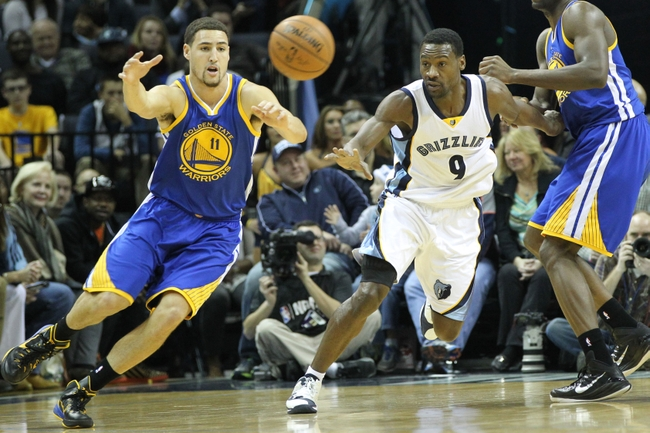 Dec 16, 2014; Memphis, TN, USA; Golden State Warriors guard Klay Thompson (11) reaches for a loose ball as Memphis Grizzlies guard Tony Allen (9) looks on at FedExForum. Mandatory Credit: Nelson Chenault-USA TODAY Sports