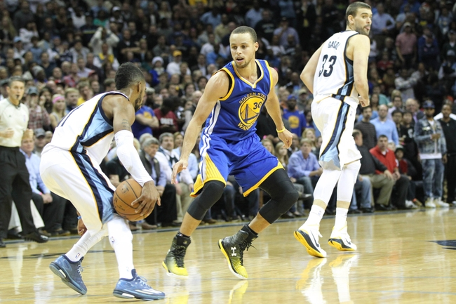 Dec 16, 2014; Memphis, TN, USA; Golden State Warriors guard Stephen Curry (30) defends against Memphis Grizzlies guard Mike Conley (11) as center Marc Gasol (33) looks over his shoulder at FedExForum. Mandatory Credit: Nelson Chenault-USA TODAY Sports