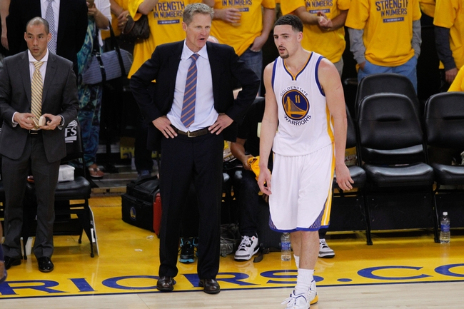 May 3, 2015; Oakland, CA, USA; Golden State Warriors head coach Steve Kerr talks with guard Klay Thompson (11) during a break in the action against the Memphis Grizzlies during the fourth quarter in game one of the second round of the NBA Playoffs at Oracle Arena. The Warriors defeated the Grizzlies 101-86. Mandatory Credit: Cary Edmondson-USA TODAY Sports