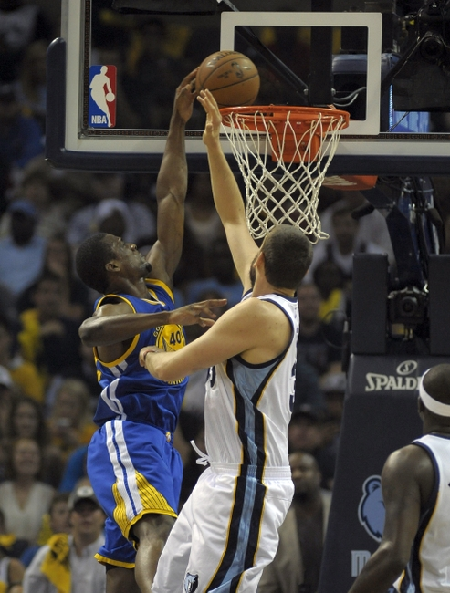 May 11, 2015; Memphis, TN, USA; Golden State Warriors forward Harrison Barnes (40) dunks the ball against Memphis Grizzlies center Marc Gasol (33) in game four of the second round of the NBA Playoffs at FedExForum. Mandatory Credit: Justin Ford-USA TODAY Sports