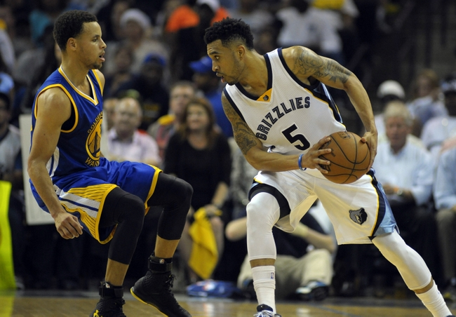 May 11, 2015; Memphis, TN, USA; Golden State Warriors guard Stephen Curry (30) guards Memphis Grizzlies guard Courtney Lee (5) in game four of the second round of the NBA Playoffs at FedExForum. Golden State Warriors beat Memphis Grizzlies 101-84. Mandatory Credit: Justin Ford-USA TODAY Sports