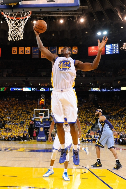 May 5, 2015; Oakland, CA, USA; Golden State Warriors forward Harrison Barnes (40) grabs a rebound during the first quarter in game two of the second round of the NBA Playoffs against the Memphis Grizzlies at Oracle Arena. The Grizzlies defeated the Warriors 97-90. Mandatory Credit: Kyle Terada-USA TODAY Sports