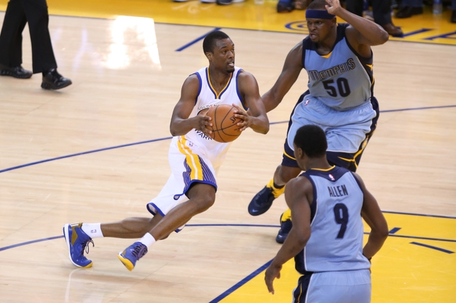May 5, 2015; Oakland, CA, USA; Golden State Warriors forward Harrison Barnes (40) drives in against Memphis Grizzlies forward Zach Randolph (50) during the third quarter in game two of the second round of the NBA Playoffs at Oracle Arena. Mandatory Credit: Kelley L Cox-USA TODAY Sports