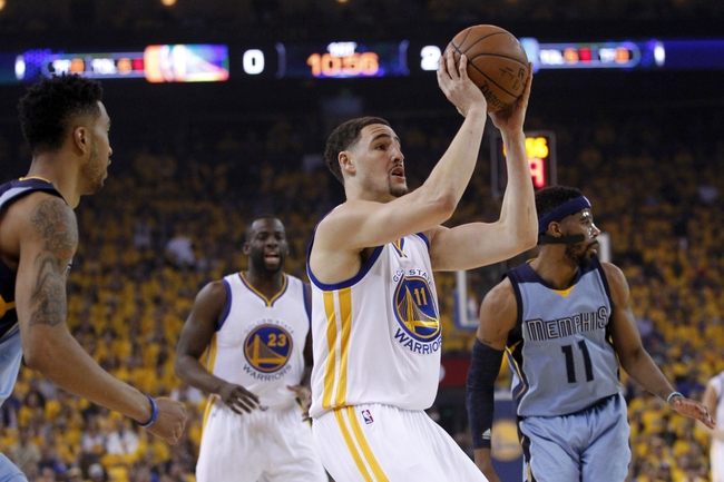 May 13, 2015; Oakland, CA, USA; Golden State Warriors guard Klay Thompson (11) attempts a shot against the Memphis Grizzlies in the first quarter in game five of the second round of the NBA Playoffs at Oracle Arena. Mandatory Credit: Cary Edmondson-USA TODAY Sports