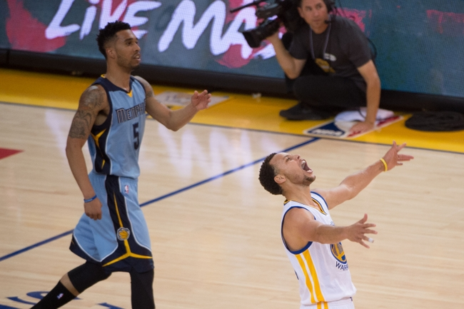 May 13, 2015; Oakland, CA, USA; Golden State Warriors guard Stephen Curry (30, right) celebrates after making a three-point basket against Memphis Grizzlies guard Courtney Lee (5) during the first quarter in game five of the second round of the NBA Playoffs at Oracle Arena. Mandatory Credit: Kyle Terada-USA TODAY Sports