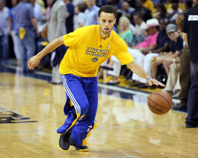 May 15, 2015; Memphis, TN, USA; Golden State Warriors guard Stephen Curry warms up prior to the game against the Memphis Grizzlies in game six of the second round of the NBA Playoffs at FedExForum. Mandatory Credit: Nelson Chenault-USA TODAY Sports