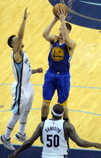May 15, 2015; Memphis, TN, USA; Golden State Warriors guard Klay Thompson (11) shoots over Memphis Grizzlies guard Courtney Lee (5) during game six of the second round of the NBA Playoffs at FedExForum. Golden State Warriors beat Memphis Grizzlies 108-95. Mandatory Credit: Justin Ford-USA TODAY Sports