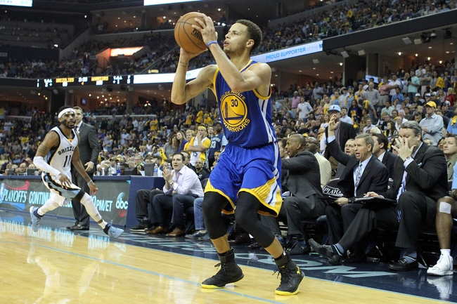 May 15, 2015; Memphis, TN, USA; Golden State Warriors guard Stephen Curry (30) sets to shoot as Memphis Grizzlies guard Mike Conley (11) looks on in game six of the second round of the NBA Playoffs at FedExForum. Warriors defeated the Grizzlies 108-95. Mandatory Credit: Nelson Chenault-USA TODAY Sports