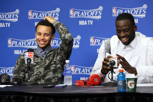 May 15, 2015; Memphis, TN, USA; Golden State Warriors guard Stephen Curry (left) and forward Draymond Green speak to the media following game six of the second round of the NBA Playoffs against the Memphis Grizzlies at FedExForum. Warriors defeated the Grizzlies 108-95. Mandatory Credit: Nelson Chenault-USA TODAY Sports