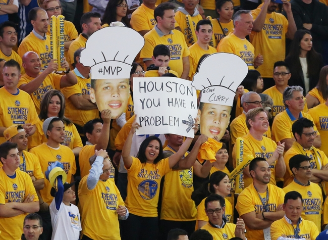 May 19, 2015; Oakland, CA, USA; Golden State Warriors fans hold up signs in the second half in game one of the Western Conference Finals of the NBA Playoffs against the Houston Rockets at Oracle Arena. Mandatory Credit: Kelley L Cox-USA TODAY Sports
