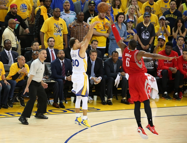 May 21, 2015; Oakland, CA, USA; Golden State Warriors guard Stephen Curry (30) shoots against the defense of Houston Rockets forward Terrence Jones (6) during the second half in game two of the Western Conference Finals of the NBA Playoffs. at Oracle Arena. Mandatory Credit: Kelley L Cox-USA TODAY Sports