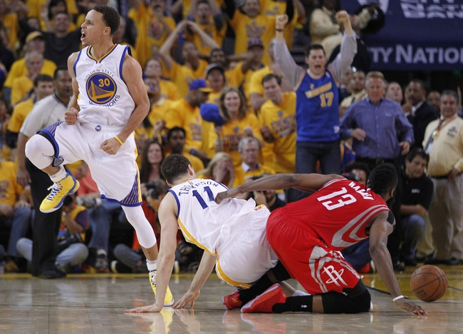 May 21, 2015; Oakland, CA, USA; Golden State Warriors guard Stephen Curry (30) celebrates the 99-98 victory after Houston Rockets guard James Harden (13) turns the ball over during the second half in game two of the Western Conference Finals of the NBA Playoffs. at Oracle Arena. Mandatory Credit: Cary Edmondson-USA TODAY Sports