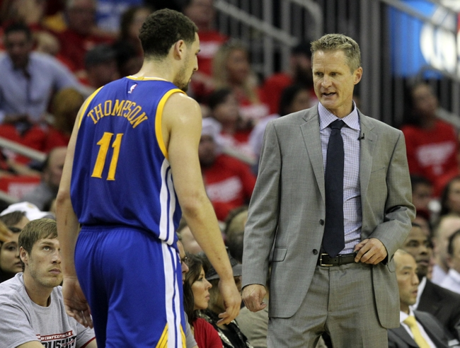 May 23, 2015; Houston, TX, USA; Golden State Warriors head coach Steve Kerr speaks with guard Klay Thompson (11) during the first half against the Houston Rockets in game three of the Western Conference Finals of the NBA Playoffs at Toyota Center. Mandatory Credit: Troy Taormina-USA TODAY Sports