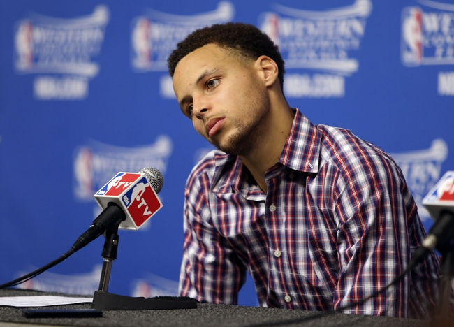May 25, 2015; Houston, TX, USA; Golden State Warriors guard Stephen Curry (30) speaks to the media after the loss to the Houston Rockets in game four of the Western Conference Finals of the NBA Playoffs. at Toyota Center. Mandatory Credit: Troy Taormina-USA TODAY Sports