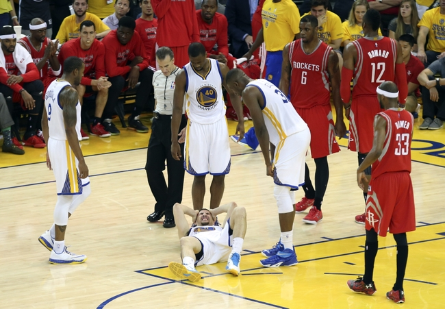 May 27, 2015; Oakland, CA, USA; Golden State Warriors guard Klay Thompson (11) lays injured during the fourth quarter against the Houston Rockets in game five of the Western Conference Finals of the NBA Playoffs at Oracle Arena. Mandatory Credit: Kelley L Cox-USA TODAY Sports