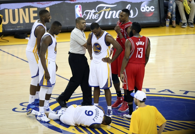 May 27, 2015; Oakland, CA, USA; Golden State Warriors guard Andre Iguodala (9) lays injured during the fourth quarter against the Houston Rockets in game five of the Western Conference Finals of the NBA Playoffs at Oracle Arena. Mandatory Credit: Kelley L Cox-USA TODAY Sports
