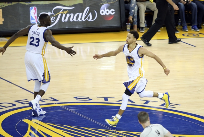 May 27, 2015; Oakland, CA, USA; Golden State Warriors guard Stephen Curry (30) celebrates with forward Draymond Green (23) during the fourth quarter against the Houston Rockets in game five of the Western Conference Finals of the NBA Playoffs at Oracle Arena. Mandatory Credit: Kelley L Cox-USA TODAY Sports