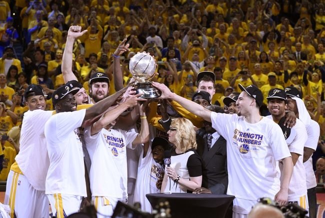 May 27, 2015; Oakland, CA, USA; (Editor's Note: Caption Correction) Golden State Warriors players celebrate with the western conference championship trophy after defeating the Houston Rockets in game five of the Western Conference Finals of the NBA Playoffs at Oracle Arena. Mandatory Credit: Kyle Terada-USA TODAY Sports