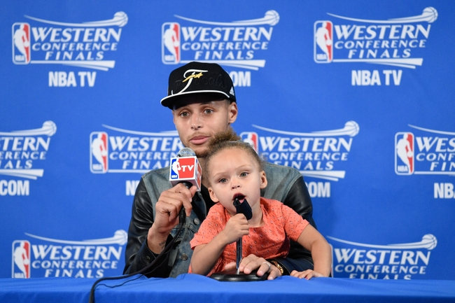 May 27, 2015; Oakland, CA, USA; Golden State Warriors guard Stephen Curry (30) and Riley Curry address the media in a press conference after game five of the Western Conference Finals of the NBA Playoffs against the Houston Rockets at Oracle Arena. Mandatory Credit: Kyle Terada-USA TODAY Sports