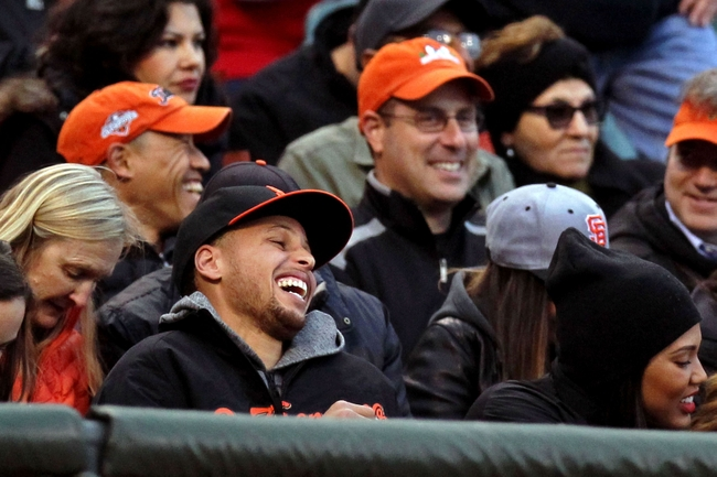 May 29, 2015; San Francisco, CA, USA; Golden State Warriors Stephen Curry is all smiles after the San Francisco Giants fans acknowledged Curry by chanting MVP at the end of the first inning between the Giants and the Atlanta Braves MLB baseball game at AT&T Park. Mandatory Credit: Lance Iversen-USA TODAY Sports.