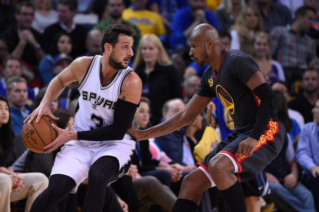 February 20, 2015; Oakland, CA, USA; San Antonio Spurs forward Marco Belinelli (3) controls the basketball against Golden State Warriors guard Leandro Barbosa (19) during the second quarter at Oracle Arena. The Warriors defeated the Spurs 110-99. Mandatory Credit: Kyle Terada-USA TODAY Sports