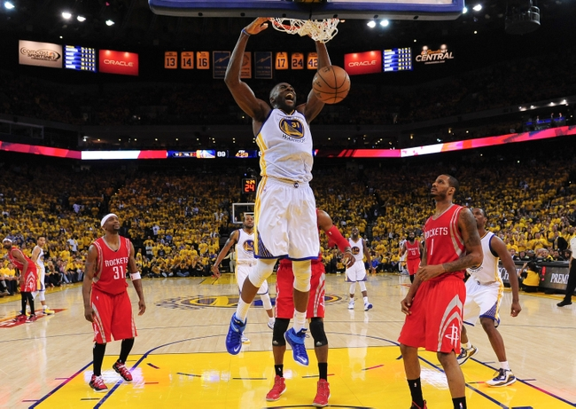 May 27, 2015; Oakland, CA, USA; Golden State Warriors center Festus Ezeli (31) dunks as Houston Rockets forward Trevor Ariza (1) looks on during the fourth quarter in game five of the Western Conference Finals of the NBA Playoffs at Oracle Arena. Mandatory Credit: Kyle Terada-USA TODAY Sports