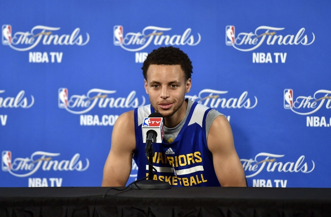 Jun 3, 2015; Oakland, CA, USA; Golden State Warriors guard Stephen Curry (30) talks to the media after practice prior to the NBA Finals at Oracle Arena. Mandatory Credit: Bob Donnan-USA TODAY Sports