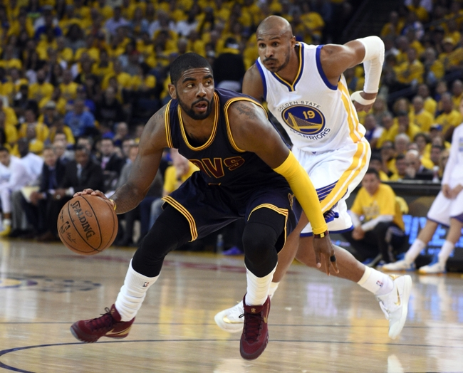Jun 4, 2015; Oakland, CA, USA; Cleveland Cavaliers guard Kyrie Irving (2) drives to the basket against Golden State Warriors guard Leandro Barbosa (19) during the second quarter in game one of the NBA Finals at Oracle Arena. Mandatory Credit: Kyle Terada-USA TODAY Sports