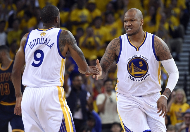 Jun 4, 2015; Oakland, CA, USA; Golden State Warriors center Marreese Speights (5) celebrates worth Golden State Warriors guard Andre Iguodala (9) during the second quarter in game one of the NBA Finals at Oracle Arena. Mandatory Credit: Kyle Terada-USA TODAY Sports