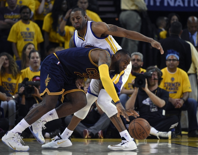 June 4, 2015; Oakland, CA, USA; Cleveland Cavaliers forward LeBron James (23) moves the ball against the defense of Golden State Warriors guard Andre Iguodala (9) during the overtime period in game one of the NBA Finals. at Oracle Arena. Mandatory Credit: Kyle Terada-USA TODAY Sports