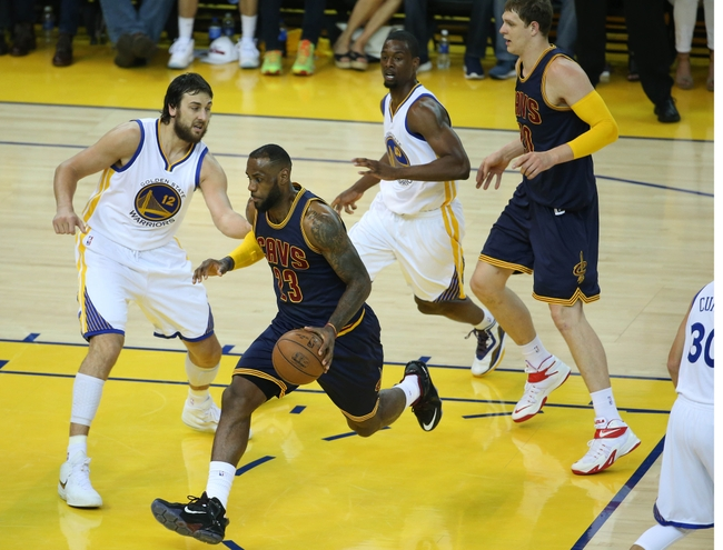 June 7, 2015; Oakland, CA, USA; Cleveland Cavaliers forward LeBron James (23) moves to the basket against Golden State Warriors center Andrew Bogut (12), forward Harrison Barnes (40) during the first half in game two of the NBA Finals at Oracle Arena. Mandatory Credit: Kelley L Cox-USA TODAY Sports