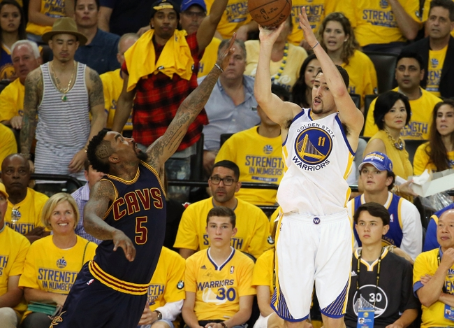 June 7, 2015; Oakland, CA, USA; Golden State Warriors guard Klay Thompson (11) shoots against the defense of Cleveland Cavaliers guard J.R. Smith (5) during the second half in game two of the NBA Finals at Oracle Arena. Mandatory Credit: Kelley L Cox-USA TODAY Sports