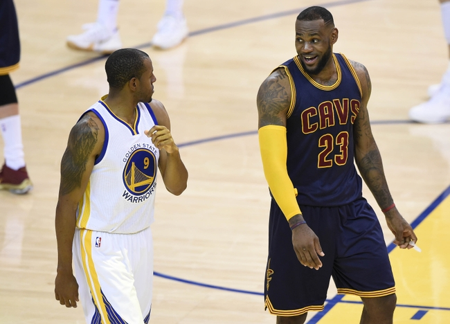 June 7, 2015; Oakland, CA, USA; Cleveland Cavaliers forward LeBron James (23) speaks to Golden State Warriors guard Andre Iguodala (9) during a stoppage in play in the second half of game two of the NBA Finals at Oracle Arena. Mandatory Credit: Bob Donnan-USA TODAY Sports