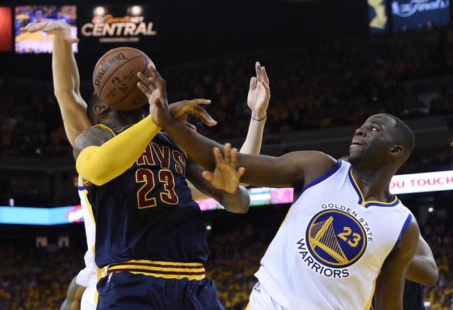 Jun 7, 2015; Oakland, CA, USA; Golden State Warriors forward Draymond Green (23) knocks the ball away from Cleveland Cavaliers forward LeBron James (23) during overtime in game two of the NBA Finals at Oracle Arena. Mandatory Credit: Kyle Terada-USA TODAY Sports