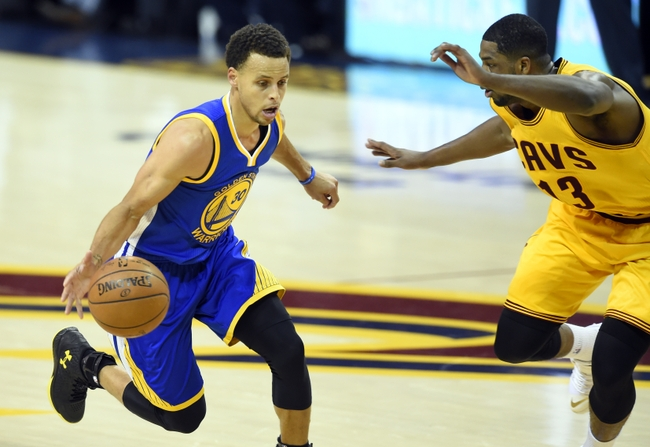 Jun 9, 2015; Cleveland, OH, USA; Golden State Warriors guard Stephen Curry (30) drives against Cleveland Cavaliers center Tristan Thompson (13) during the first quarter of game three of the NBA Finals at Quicken Loans Arena. Mandatory Credit: David Richard-USA TODAY Sports