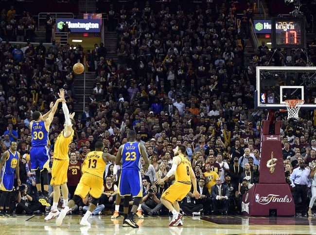 Jun 9, 2015; Cleveland, OH, USA; Golden State Warriors guard Stephen Curry (30) shoots the ball during the fourth quarter against the Cleveland Cavaliers in game three of the NBA Finals at Quicken Loans Arena. Mandatory Credit: Bob Donnan-USA TODAY Sports