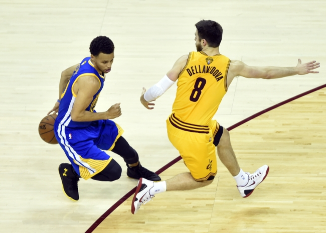 Jun 11, 2015; Cleveland, OH, USA; Golden State Warriors guard Stephen Curry (30) controls the ball against Cleveland Cavaliers guard Matthew Dellavedova (8) during the first quarter of game four of the NBA Finals at Quicken Loans Arena. Mandatory Credit: Ken Blaze-USA TODAY Sports