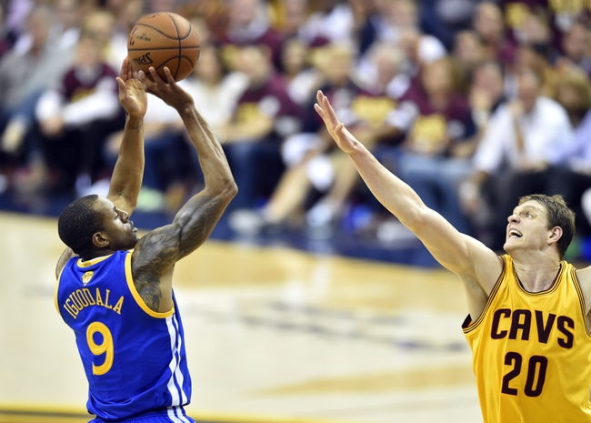 Jun 11, 2015; Cleveland, OH, USA; Golden State Warriors guard Andre Iguodala (9) shoots against Cleveland Cavaliers center Timofey Mozgov (20) during the third quarter of game four of the NBA Finals at Quicken Loans Arena. Mandatory Credit: David Richard-USA TODAY Sports