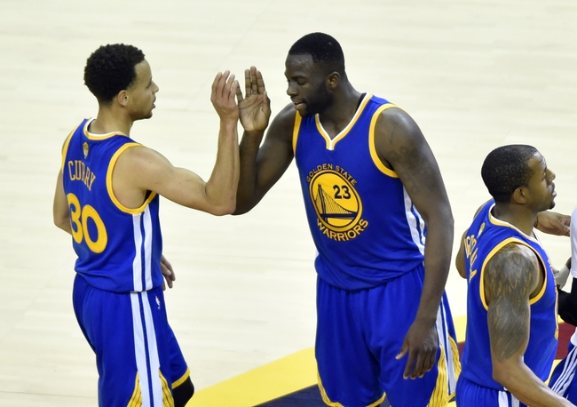 Jun 11, 2015; Cleveland, OH, USA; Golden State Warriors guard Stephen Curry (30) celebrates with Golden State Warriors forward Draymond Green (23) during the fourth quarter of game four of the NBA Finals against the Cleveland Cavaliers at Quicken Loans Arena. Mandatory Credit: Ken Blaze-USA TODAY Sports