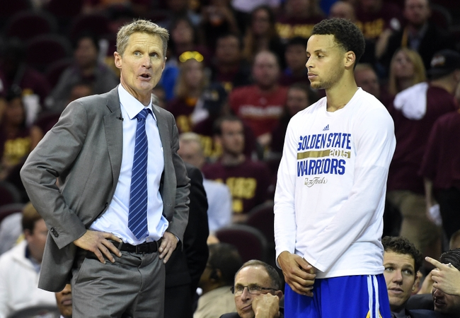 Jun 11, 2015; Cleveland, OH, USA; Golden State Warriors head coach Steve Kerr talks to guard Stephen Curry (30) during the fourth quarter against the Cleveland Cavaliers in game four of the NBA Finals at Quicken Loans Arena. Mandatory Credit: Bob Donnan-USA TODAY Sports