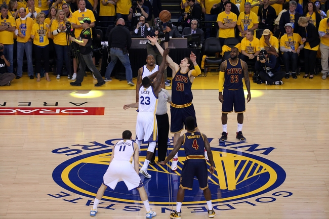 June 14, 2015; Oakland, CA, USA; Cleveland Cavaliers center Timofey Mozgov (20) takes the opening tipoff against Golden State Warriors forward Draymond Green (23) in the first half in game five of the NBA Finals. at Oracle Arena. Mandatory Credit: Kelley L Cox-USA TODAY Sports