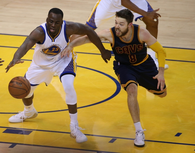 June 14, 2015; Oakland, CA, USA; Golden State Warriors forward Draymond Green (23) / plays for the ball against the defense of Cleveland Cavaliers guard Matthew Dellavedova (8) in the first half in game five of the NBA Finals. at Oracle Arena. Mandatory Credit: Kelley L Cox-USA TODAY Sports