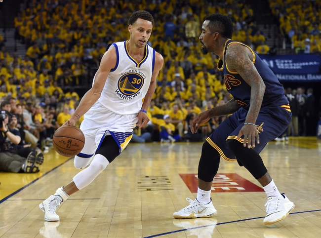 Jun 14, 2015; Oakland, CA, USA; Golden State Warriors guard Stephen Curry (30) drives to the basket against Cleveland Cavaliers guard J.R. Smith (5) during the third quarter in game five of the NBA Finals at Oracle Arena. Mandatory Credit: Bob Donnan-USA TODAY Sports