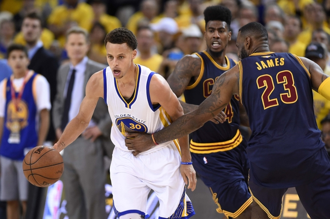 Jun 14, 2015; Oakland, CA, USA; Golden State Warriors guard Stephen Curry (30) brings the ball up court against Cleveland Cavaliers forward LeBron James (23) during the fourth quarter in game five of the NBA Finals at Oracle Arena. Mandatory Credit: Bob Donnan-USA TODAY Sports
